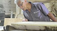 Wood Table Being Cut by Hand Stock Footage