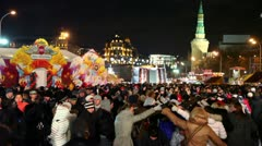 Many people celebrate maslenitsa at background of night cityscape Stock Footage