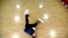 Young breakdancer moves on parquet Stock Footage