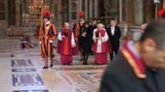 Priests and swiss guard in Basilica of St Peter's in Vatican city Stock Footage
