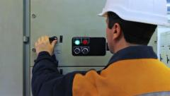 Engineer Turns Off Equipment Closeup Stock Footage