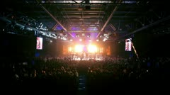 Lot of people in large hall with bright light on fighting event Stock Footage