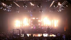 Lot of people in hall on fighting event, girls dance on stage Stock Footage