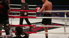 Vladimir Voitekhovsky on boxing ring, referee directs athletes into corners Stock Footage