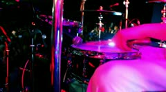 Drummer in white costume holds drumsticks and play Stock Footage