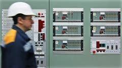 Engineer Comes To Gas Panel And Check Stock Footage