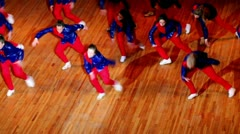 Girls team in red blue suit dance Stock Footage