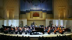 Stock Video Footage of Grand piano and Symphony Orchestra of Moscow State Conservatory