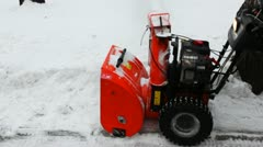 Man cleans snow with small manual machines Stock Footage