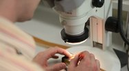 Scientist performes microscope test in a laboratory Stock Footage