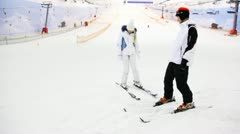 skier instructor argue with girl what will be better for her in indoor ski - stock footage