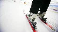 Close-up of skiers legs with skis that fast ride on snow Stock Footage