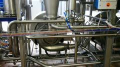 Stock Video Footage of dairy equipment and pipes, panorama from bottom up