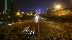 Cars go on night high-speed road towards Guangzhou Bridge Stock Footage