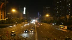 Cars quickly go on highway to Guangzhou Bridge in night Stock Footage