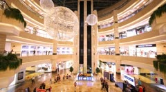 People walk and are engaged in purchases in shopping centre AfiMall City Stock Footage
