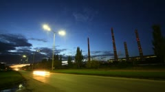Cars go on highway in front of chimney shaft of manufacturing plant AUTOVAZ Stock Footage
