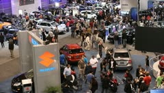 busy auto show people congested cars manufactuers - stock footage