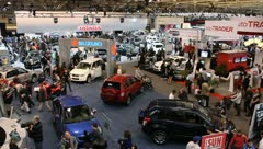 Busy auto show people congested cars manufactuers Stock Footage