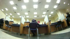 Client sit on chair and makes transaction in bank Stock Footage