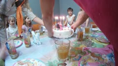 Hands of adult cut torte on birthday of child Stock Footage