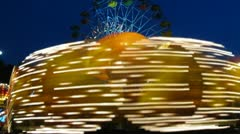 Fellow merry-go-round is shone by multi-colored light in park Sokolniki Stock Footage