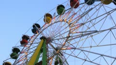 Observation wheel works in evening in park closeup Stock Footage