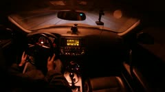 Man drives in car salon on high-speed highway at night Stock Footage