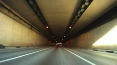 Cars leave tunnel and go on highway on Third Transport Ring Stock Footage