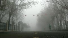 People go along on street shrouded in fog Stock Footage