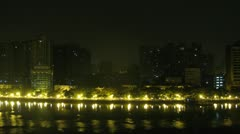 Night is replaced by dawn on quay of Pearl river Stock Footage