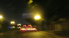 Motorcyclist goes in city on road in night Stock Footage