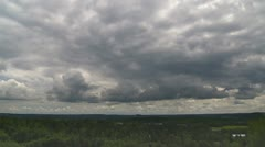 Heavy clouds moving across the skyline - stock footage