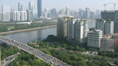 Twin Tower stands up for Guangzhou bridge Stock Footage