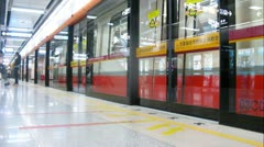 Glass door is closed before train in subway Stock Footage