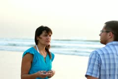 Relationship difficulties, young couple fighting by the beach, steadicam shot Stock Footage