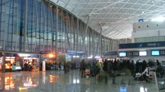People stand in a queue in eveying Central terminal on airport Divopu Stock Footage