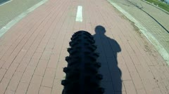 Subjective on bike with man shadow Stock Footage