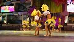 Children and teens dance in the Carnival Junior Queen competition Stock Footage