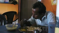 Indian man eats Stock Footage
