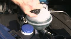 Removing/installing the filler cap of the coolant expansion tank Stock Footage