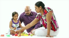 Young couple playing with their daughter Stock Footage