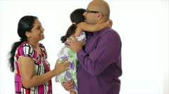 Young Indian couple kissing their daughter Stock Footage