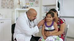 Cute little girl getting an ear checkup - stock footage