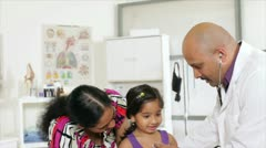 An Indian doctor checking a child Stock Footage
