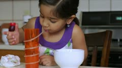 Cute little girl drinking juice and eating Stock Footage