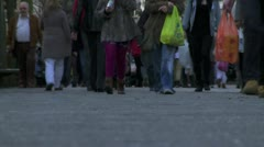 Low angle of busy feet on a high street Stock Footage