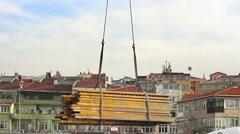 Crane lifting steel bars Stock Footage