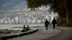 Stanley Park Sea Wall And West Vancouver Stock Footage
