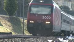 Stock Video Footage of High Speed Train Flies Past Close To Camera